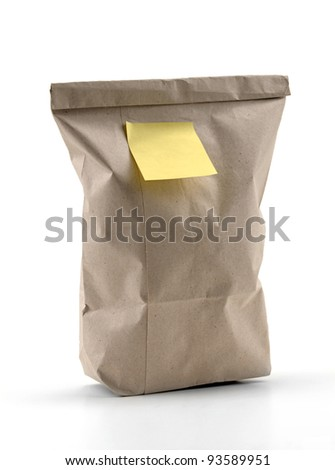 Yellow note paper on recycled shopping bag. - stock photo