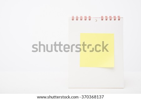 yellow note paper on  white blank Calendar  - stock photo