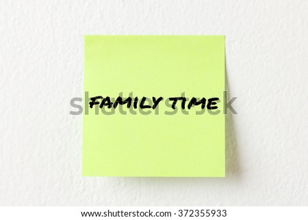 Yellow note paper with words Family on the white wall - stock photo