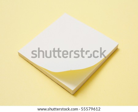 Yellow notepad - stock photo