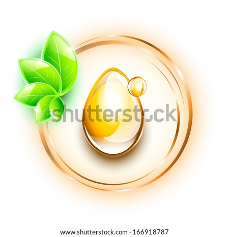 Yellow oil drops in rings, with small plant - stock photo