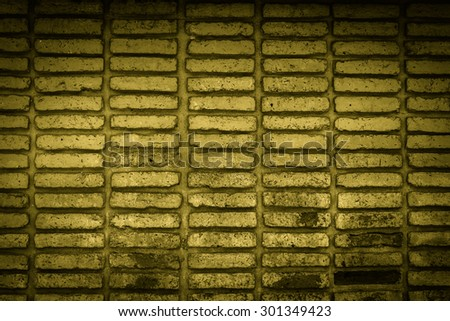 yellow old brick wall texture background - stock photo