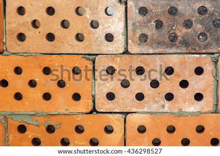 Yellow old dirty bricks pattern background - stock photo