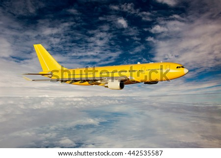 Yellow / Orange passenger airplane aircraft is flying high in the blue cloudy sky - stock photo