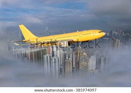 Yellow-orange plane flies in clouds over the city. Under the aircraft wings visible buildings and skyscrapers. - stock photo