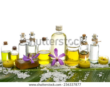 Yellow orchid and pile of salt ,oil with burning candle, on banana leaf  - stock photo