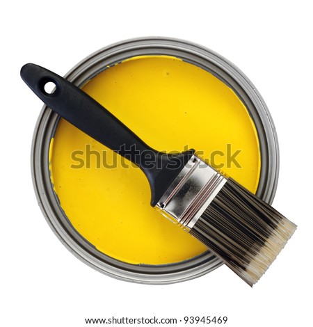 yellow paint with paint brush over white background - stock photo