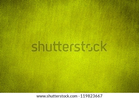 Yellow painted metal plate background texture. Dark edged - stock photo