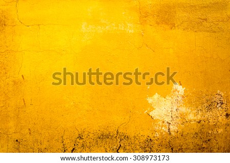 Yellow painted old dirty concrete wall texture or background - stock photo