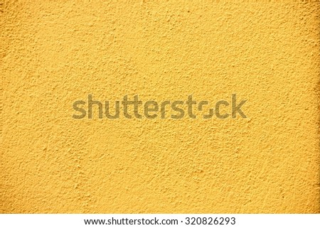 Yellow painted rough wall texture. - stock photo