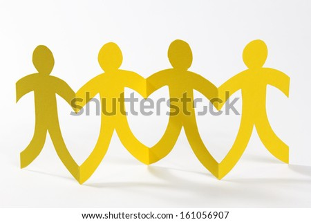 yellow paper people in a row - stock photo