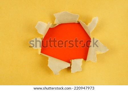 Yellow paper with hole - stock photo