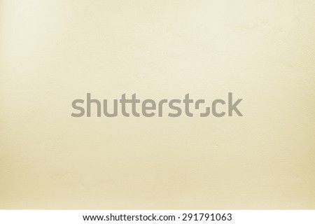 yellow pastel color paint on cement wall, Texture background. - stock photo