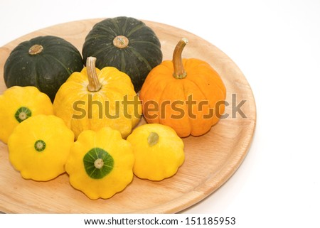 Yellow Patty Pan And Pumpkin on the wooden tray - stock photo