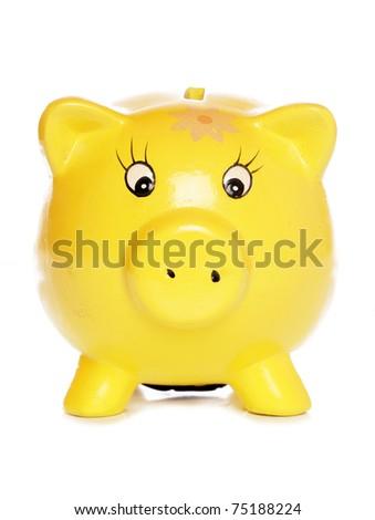yellow piggybank isolated on white - stock photo