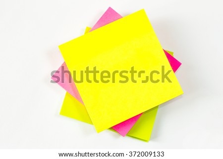 Yellow, pink, green sticky note isolated on white background. - stock photo