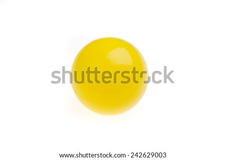 Yellow plastic ball on white background - stock photo