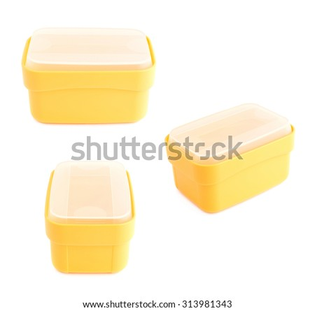 Yellow plastic tableware food container, closed with the white cap, isolated over the white background, set of three foreshortenings - stock photo