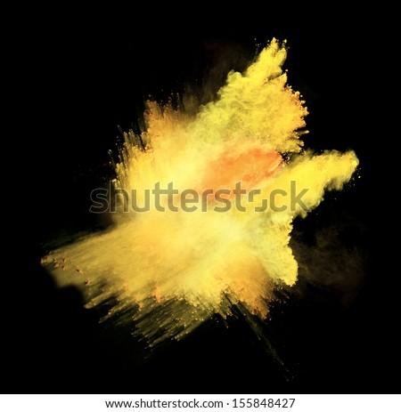 Yellow powder isolated on black background - stock photo