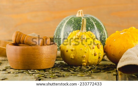 Yellow Pumpkins  on  wooden background. Selective focus - stock photo