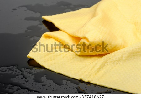 yellow PVA chamois for car cleaning - stock photo