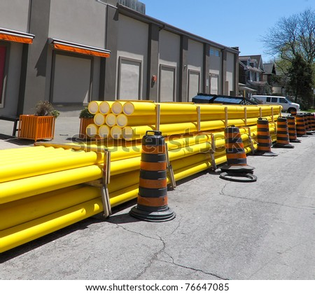 Yellow PVC piping for utility upgrade - stock photo