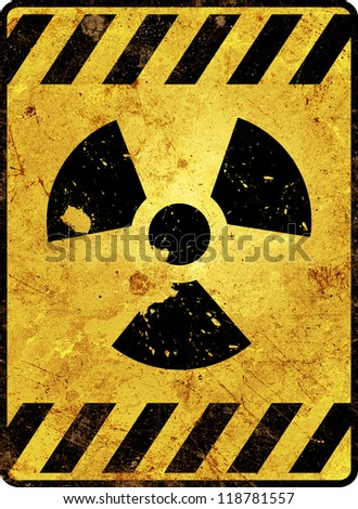 Yellow radioactivity warning sign - stock photo