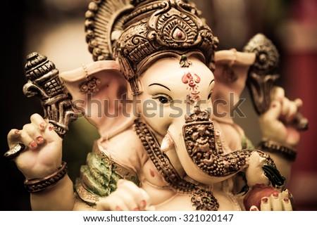 Yellow rasin Ganesh Elephant god statue  closeup focused on face   - stock photo
