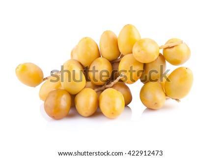 yellow raw dates isolated on white background. - stock photo
