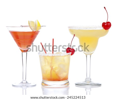 Yellow red alcohol margarita martini cocktails composition with lemon and cherry in cocktail glasses isolated on a white background  - stock photo