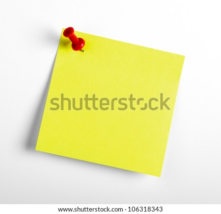 Yellow reminder note with red pin isolated on the white background. - stock photo