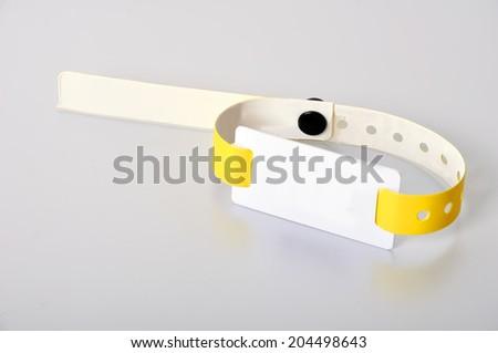 yellow rfid id bracelet, close up - stock photo
