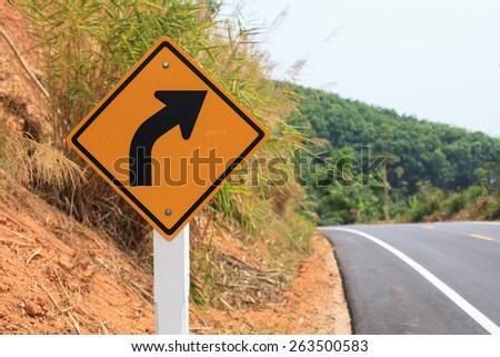 Yellow right turn road sign - stock photo