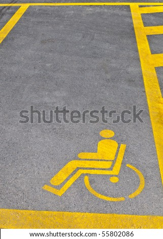 Yellow road marking for disabled parking space - stock photo
