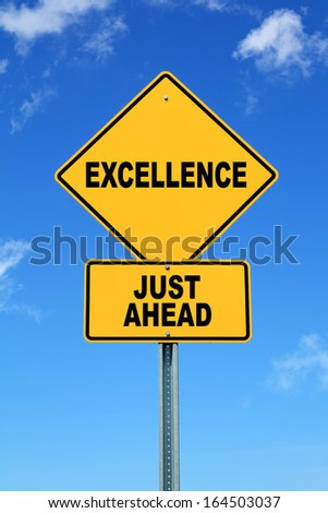 Yellow road sign excellence just ahead - stock photo