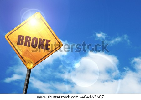 Yellow road sign with a blue sky and white clouds: broke - stock photo