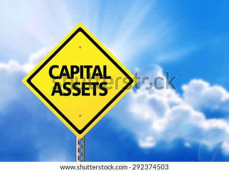 Yellow road sign with text capital assets. - stock photo