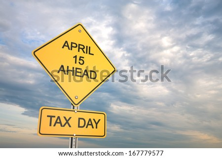 Yellow road warning sign , Tax day  - stock photo