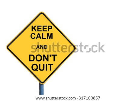 Yellow roadsign with KEEP CALM AND DON'T QUIT message isolated on white background - stock photo