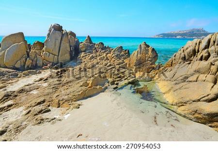 yellow rocks in santa reparata shoreline, Sardinia - stock photo