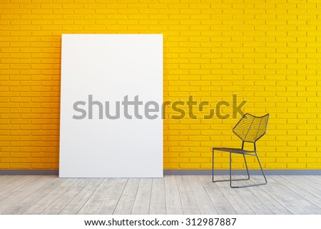 yellow room with blank picture and chair - stock photo