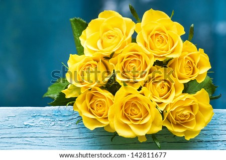 Yellow Roses Bouquet on the blue wood - stock photo