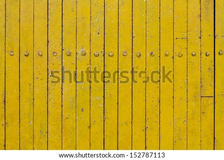 Yellow  rough vertical stripe line background. - stock photo