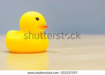 Yellow Rubber Duck isolated on the desk - stock photo