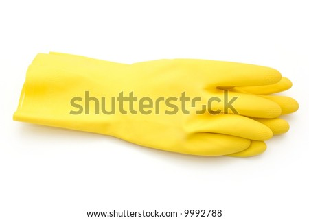 Yellow rubber gloves isolated on white - stock photo