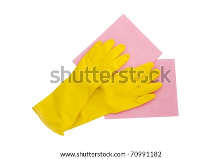 Yellow rubber gloves lay on pink cleaning napkins. On a white background - stock photo