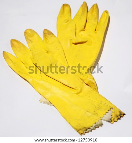 yellow rubber gloves on white represnting the cleaning industry - stock photo