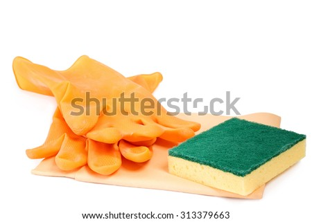 Yellow rubber gloves with scouring sponge and cloth - stock photo