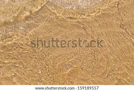 yellow sand of the sea shore waves - stock photo