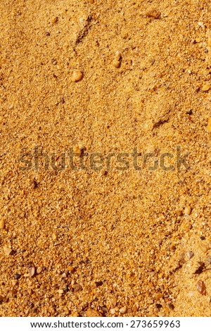 Yellow sand with small colored stones as a texture - stock photo